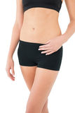 Closeup mid section of a fit woman in sportswear Stock Image