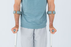 Closeup mid section of a man with crutches Stock Photography