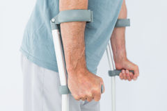 Closeup mid section of a man with crutches Stock Photos