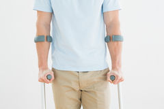 Closeup mid section of a man with crutches Royalty Free Stock Photography