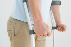 Closeup mid section of a man with crutches Stock Photo