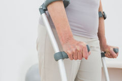 Closeup mid section of a woman with crutches Stock Images