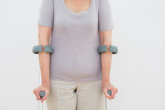 Closeup mid section of a woman with crutches Stock Photo