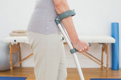 Closeup mid section of a woman with crutches Stock Image