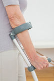 Closeup mid section of a woman with crutches Stock Photography