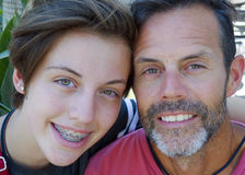 Closeup middle-aged Father and his teenage daughter stock image