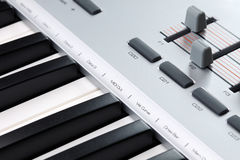 Closeup of a MIDI controller. Closeup of the keys and faders on a MIDI controller keyboard Stock Images