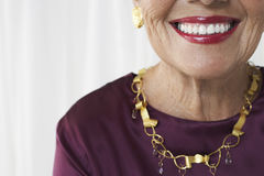 Closeup Midsection Of Smiling Senior Woman Stock Photos