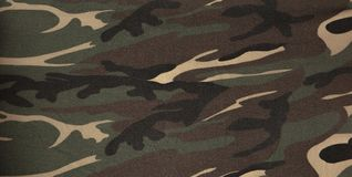 Closeup of military uniform surface. Texture of fabric, close-up, military coloring stock illustration
