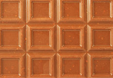 Closeup milk chocolate bar with nuts Royalty Free Stock Image