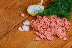 Closeup of minced pork with parsley. Close-up of chopped pork with onion minced pork Royalty Free Stock Photo