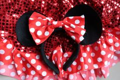 Closeup of Minnie Mouse Ears. Closeup Flatlay of Minnie Mouse ears with with red sequins and red and white polka dots stock images