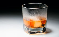 Closeup misted glass of whiskey Stock Image