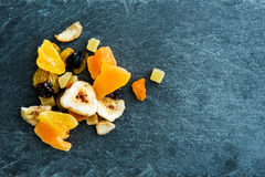 Closeup on mix of dried fruits on stone substrate Stock Photos