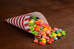Closeup mixed candy in paper cone stock image