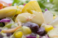 Closeup mixed of fresh salad and fruit. Stock Photos