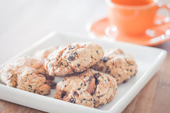 Closeup mixed nut cookies with mini orange coffee cup Stock Images
