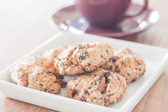Closeup mixed nut cookies with violet coffee cup Royalty Free Stock Images