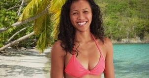 Closeup of mixed race woman smiling at the beach having fun.  stock photo