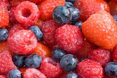 Closeup of mixed summer fruits. A closeup of a mix of strawberries, raspberries and blueberries Royalty Free Stock Photography