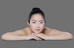Closeup model with clean skin on gray background Royalty Free Stock Photography