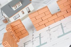 Closeup of model house construction with brick stock image
