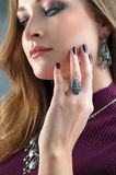 Closeup of a model wearing jewelry. Most focus is on hand.Close Royalty Free Stock Image