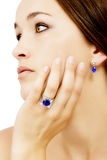 Closeup of a Model Wearing a Tanzanite Designer Ring and Earring Stock Photography