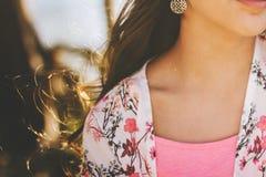 Closeup of model's neck and shoulder