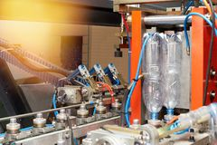 A closeup of a modern automated line for the production of plastic bottles. For water and beverages at the plant royalty free stock photography
