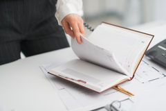 Closeup on modern business woman checking notepad Stock Images