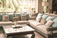 Closeup of modern furniture with pillows .( Filtered image proce Stock Photos