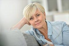 Closeup of modern senior woman at home stock photos