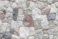Closeup the modern stone wall with cement surface background. royalty free stock photo