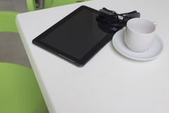 Closeup of modern tablet and coffee cup Stock Photography