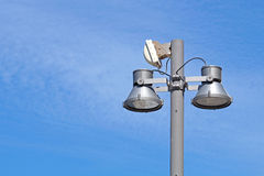 Closeup of a modern white metallic street lamppost with five lanterns against clear blue sky. Copy space Stock Photos