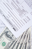 Closeup of money cash and tax form Stock Image