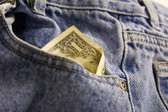 Closeup of Money in Pocket. A one and five dollar bill in US currency in jeans pocket Royalty Free Stock Photo