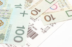Closeup of money with receipt on white background Royalty Free Stock Images