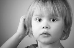 Closeup monochrome portrait of cute blond baby girl Stock Photography