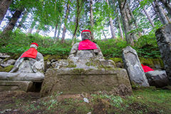 Closeup of moss covered statues of Jizo in Nikko Stock Photos