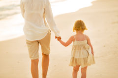 Closeup on mother and baby girl walking on beach Royalty Free Stock Image
