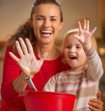 Closeup on mother and baby hands smeared in flour Royalty Free Stock Image