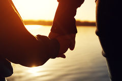 Closeup of mother and child hands at the sunset. Time.Happy family staying together and enjoying nature Stock Photography