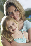 Closeup Of Mother Hugging Daughter Outdoors Royalty Free Stock Images
