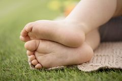 A child`s legs barefoot on grass. At picnic royalty free stock images