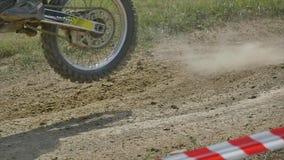 Closeup of motocross bike in dirt, slow motion.  stock footage