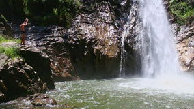 Closeup mountain river waterfall falls into lake among rocks. Closeup mountain river bright waterfall among rocks falls into transparent lake water under stock video