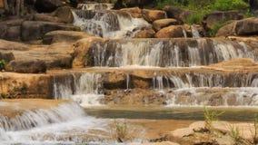 Closeup mountain stream cascade among stones in park. Closeup view of mountain stream cascade among stones in tropical park stock video