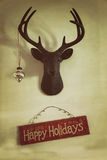 Closeup of mounted deer head with christmas ornament. And holiday sign Royalty Free Stock Photography